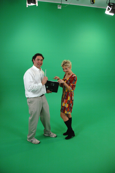 Mike Haller on left, consulting with client and actress Amy Baue on the green screen set